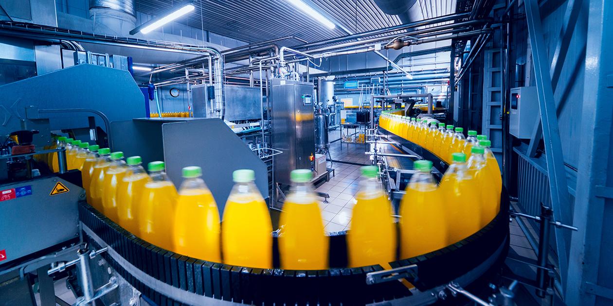 Bottles processing through a beverage bottling facility.